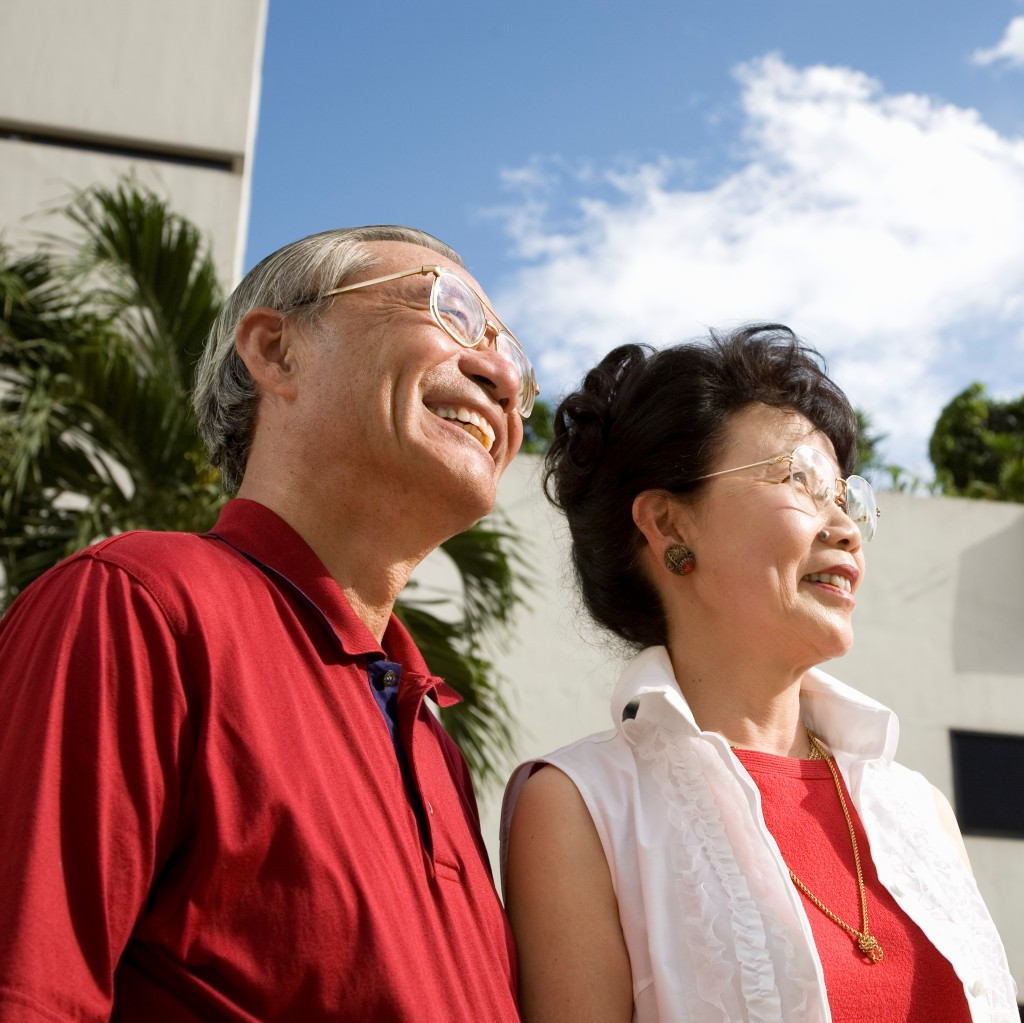asian couple smiling looking away from camera