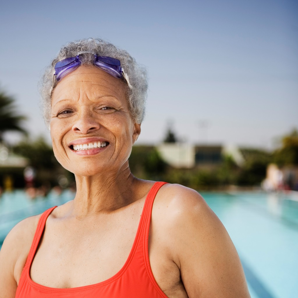 african american woman smiling in swimsuit
